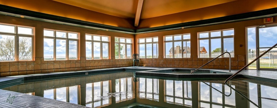 Indoor pool and hot tub with a slide  Year-Round Indoor Pool And Hot Tub | Gleniffer Lake Resort Phase 7 ...